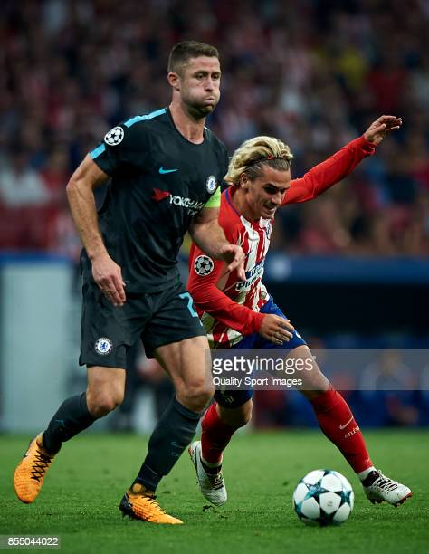 Antoine Griezmann of Atletico Madrid competes for the ball with Gary Cahill of Chelsea during the UEFA Champions League group C match between...