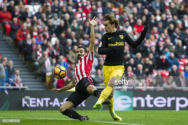 Antoine Griezmann of Atletico Madrid competes for the ball with Mikel Balenziaga of Athletic Club during the La Liga match between Athletic Club...