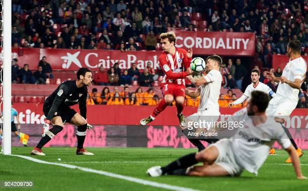Antoine Griezmann of Atletico Madrid competes for the ball with Clement Lenglet of Sevilla CF during the La Liga match between Sevilla CF and...