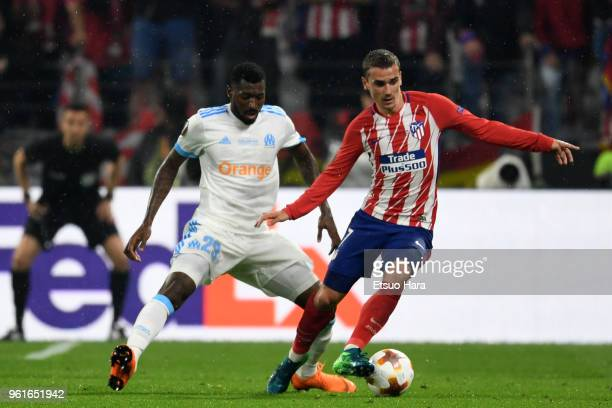 Antoine Griezmann of Atletico Madrid controls the ball under pressure of AndreFrank Zambo Anguissa of Olympique Marseille during the UEFA Europa...