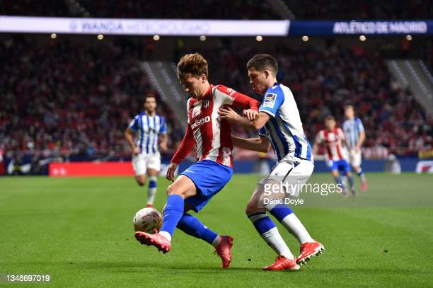 Antoine Griezmann of Atletico Madrid controls the ball whilst under pressure from Igor Zubeldia of Real Sociedad during the LaLiga Santander match...
