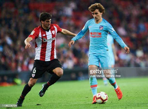 Antoine Griezmann of Atletico Madrid duels for the ball with Mikel San Jose of Athletic Club during the La Liga match between Athletic Club and Club...
