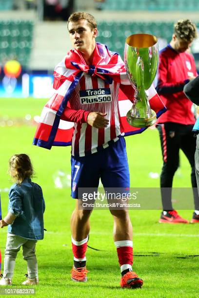 Antoine Griezmann of Atletico Madrid holds the trophy following the UEFA Super Cup between Real Madrid and Atletico Madrid at Lillekula Stadium on...