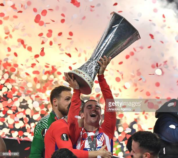 Antoine Griezmann of Atletico Madrid holds trophy as he celebrates after the UEFA Europa League final match against Olympique Marseille at the Stade...