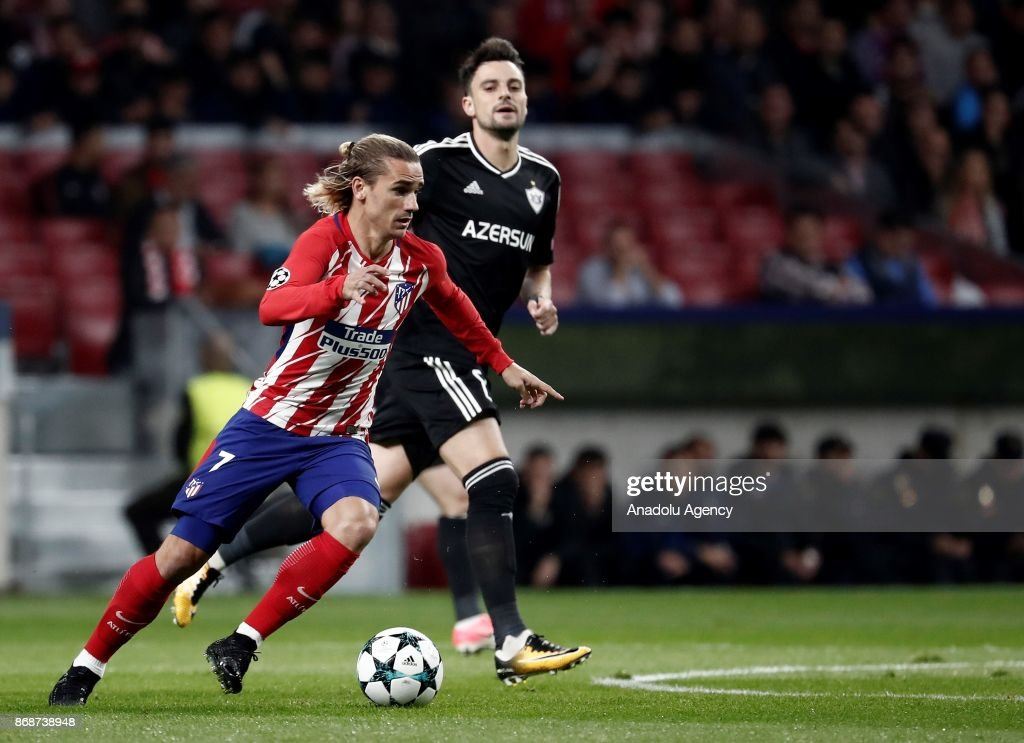 Antoine Griezmann (L) of Atletico Madrid in action against Michel Madera (R) of Qarabag FK during the UEFA Champions League Group C soccer match between Atletico Madrid and Qarabag FK at Wanda Metropolitano Stadium in Madrid, Turkey on October 31, 2017.