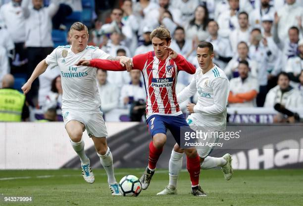 Antoine Griezmann of Atletico Madrid in action against Toni Kroos and Lucas Vazquez of Real Madrid during the La Liga soccer match between Real...