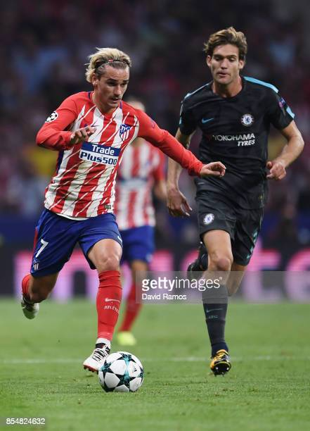 Antoine Griezmann of Atletico Madrid is chased down by Marcos Alonso of Chelsea during the UEFA Champions League group C match between Atletico...