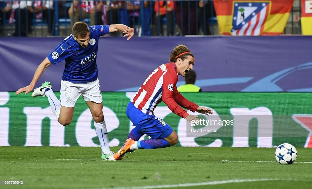 Antoine Griezmann of Atletico Madrid is fouled in the penalty area by Marc Albrighton of Leicester City during the UEFA Champions League Quarter Final first leg match between Club Atletico de Madrid and Leicester City at Vicente Calderon Stadium on April 12, 2017 in Madrid, Spain.