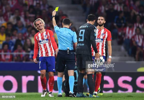 Antoine Griezmann of Atletico Madrid is shown a yellow card during the UEFA Champions League group C match between Atletico Madrid and Chelsea FC at...