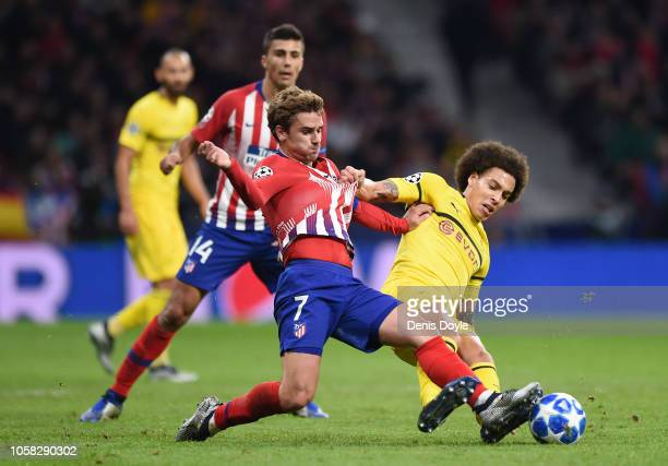 Antoine Griezmann of Atletico Madrid is tackled by Axel Witsel of Borussia Dortmund during the Group A match of the UEFA Champions League between...