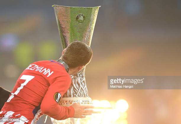 Antoine Griezmann of Atletico Madrid kisses the Europa League trophy after his team's victory in the UEFA Europa League Final between Olympique de...