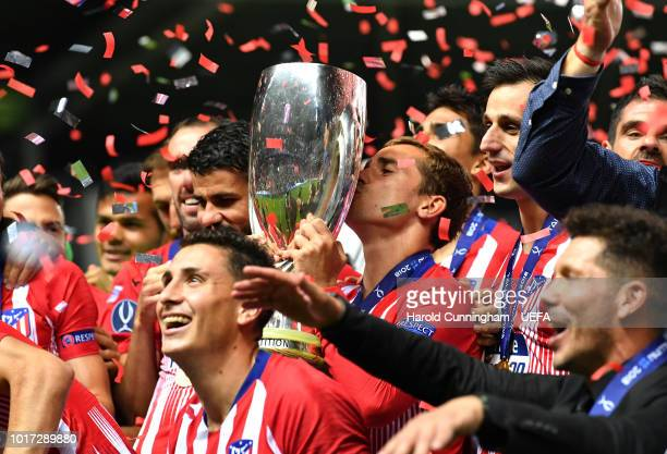 Antoine Griezmann of Atletico Madrid kisses the trophy as Atletico Madrid celebrate victory following the UEFA Super Cup between Real Madrid and...