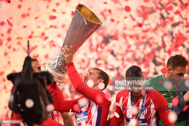 Antoine Griezmann of Atletico Madrid lifts the trophy at the end of the UEFA Europa League Final between Olympique de Marseille and Club Atletico de...