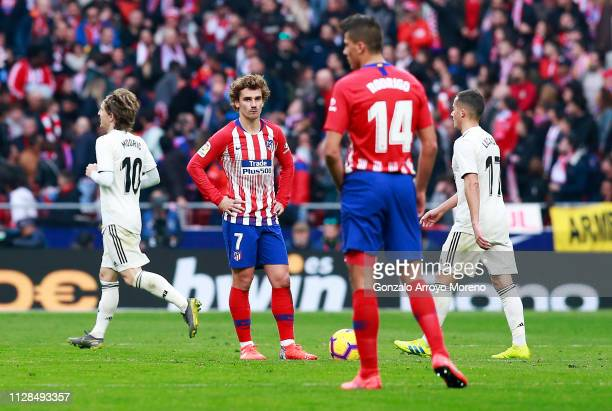 Antoine Griezmann of Atletico Madrid looks dejected during the La Liga match between Club Atletico de Madrid and Real Madrid CF at Wanda...