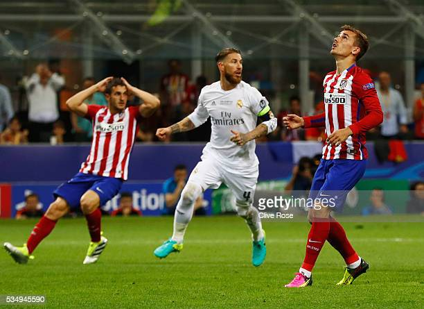 Antoine Griezmann of Atletico Madrid reacts after missing a penalty during the UEFA Champions League Final match between Real Madrid and Club...
