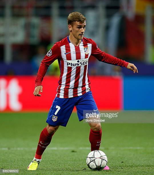 Antoine Griezmann of Atletico Madrid runs with the ball during the Champions League final match between Real Madrid and Club Atletico de Madrid at...