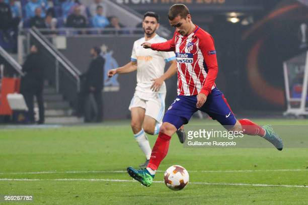 Antoine Griezmann of Atletico Madrid score the first goal during the Europa League Final match between Marseille and Atletico Madrid at Groupama...