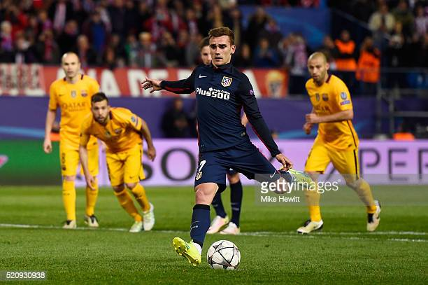 Antoine Griezmann of Atletico Madrid scores from the penalty spot for his team's second goal during the UEFA Champions League quarter final second...