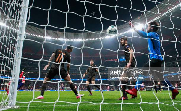Antoine Griezmann of Atletico Madrid scores his sides first goal past Alisson Becker of AS Roma during the UEFA Champions League group C match...