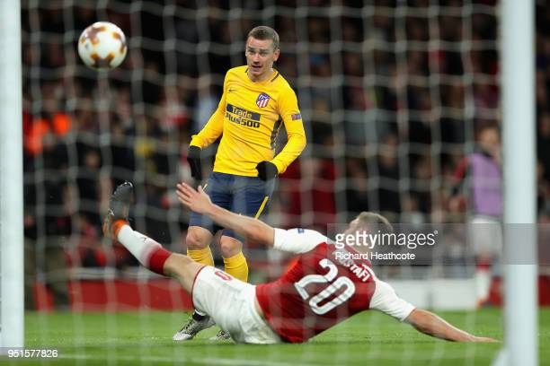 Antoine Griezmann of Atletico Madrid scores his sides first goal during the UEFA Europa League Semi Final leg one match between Arsenal FC and...