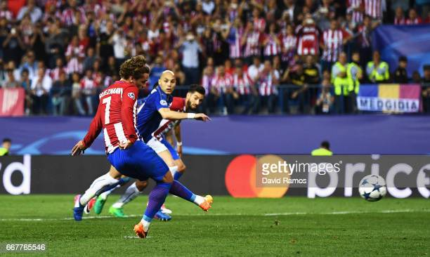 Antoine Griezmann of Atletico Madrid scores the opening goal of the game from the penalty spot during the UEFA Champions League Quarter Final first...