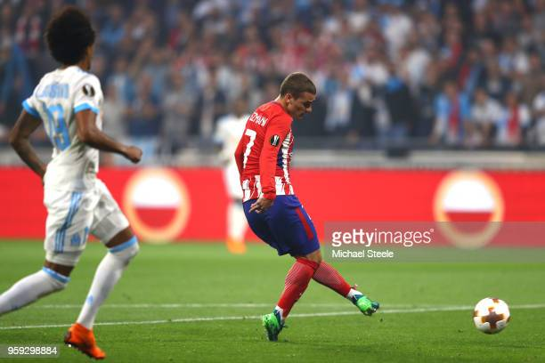 Antoine Griezmann of Atletico Madrid scores the opening goal of the game during the UEFA Europa League Final between Olympique de Marseille and Club...