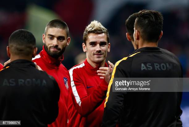 Antoine Griezmann of Atletico Madrid shakes hands with a AS Roma player during the UEFA Champions League group C match between Atletico Madrid and AS...