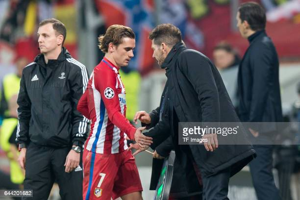 Antoine Griezmann of Atletico Madrid shakes hands with Head coach Diego Simeone of Atletico Madrid during the UEFA Champions League Round of 16 first...