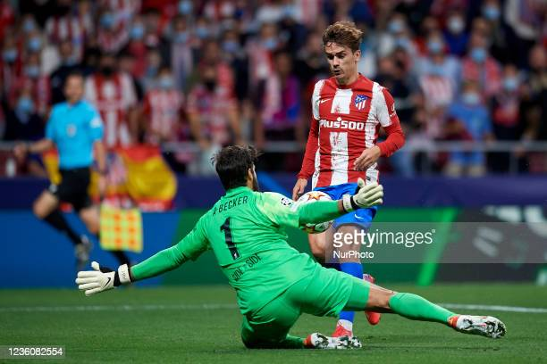 Antoine Griezmann of Atletico Madrid shooting to goal and Alisson Becker of Liverpool makes a save during the UEFA Champions League group B match...