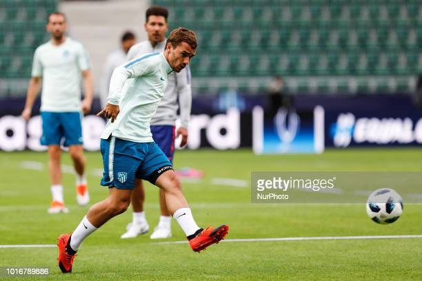 Antoine Griezmann of Atletico Madrid shoots on goal during an Atletico Madrid training session ahead of the UEFA Super Cup match against Real Madrid...