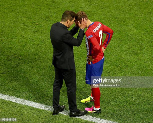 Antoine Griezmann of Atletico Madrid speaks to head coach Diego Simeone during the UEFA Champions League Final match between Real Madrid and Club...