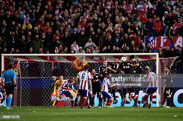 Antoine Griezmann of Atletico Madrid takes a free kick during the UEFA Champions League round of 16 match between Club Atletico de Madrid and Bayer...
