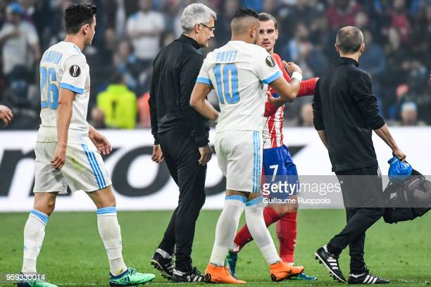 Antoine Griezmann of Atletico Madrid talks with Dimitri Payet of Marseille who leaves the pitch injured during the Europa League Final match between...