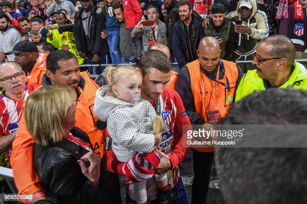 Antoine Griezmann of Atletico Madrid with his wife and his daughter during the Europa League Final match between Marseille and Atletico Madrid at...