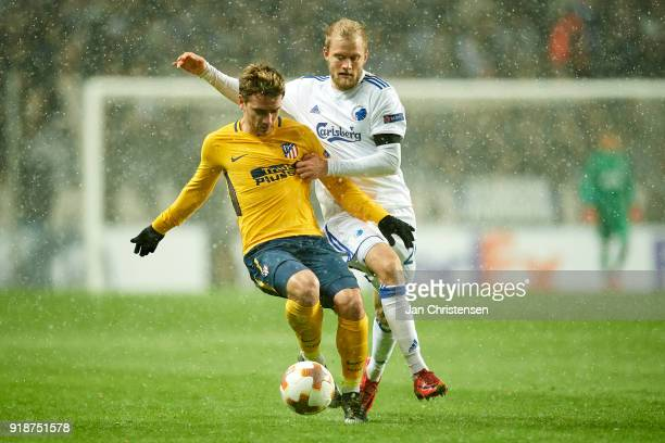 Antoine Griezmann of Atlético Madrid and Nicolai Boilesen of FC Copenhagen compete for the ball during the UEFA Europa League match between FC...
