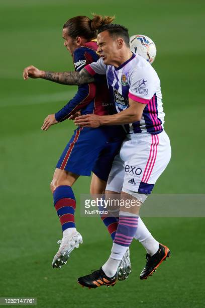 Antoine Griezmann of Barcelona and Roque Mesa of Valladolid compete for the ball during the La Liga Santander match between FC Barcelona and Real...