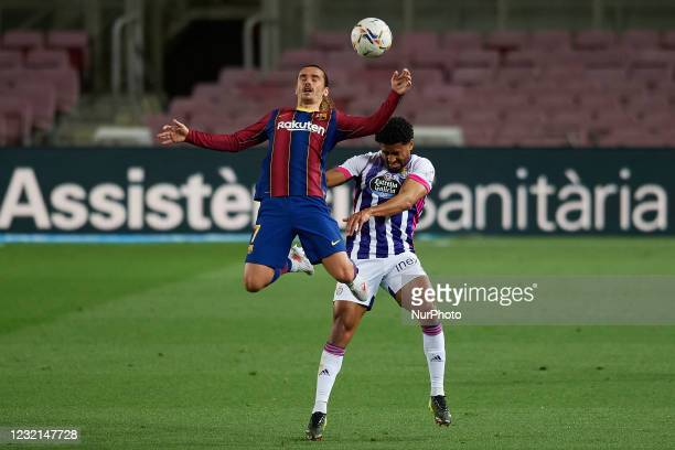 Antoine Griezmann of Barcelona and Saidy Janko of Valladolid compete for the ball during the La Liga Santander match between FC Barcelona and Real...