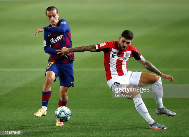 Antoine Griezmann of Barcelona and Unai Nunez of Athletic Bilbao in action during the Liga match between FC Barcelona and Athletic Club at Camp Nou...