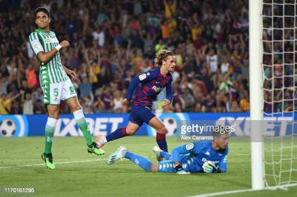 Antoine Griezmann of Barcelona celebrates scoring his team's first goal during the Liga match between FC Barcelona and Real Betis at Camp Nou on...
