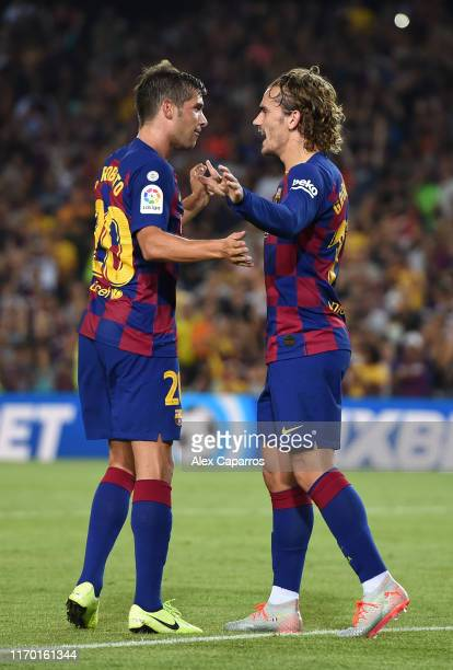 Antoine Griezmann of Barcelona celebrates scoring his team's first goal with teammate Sergi Roberto during the Liga match between FC Barcelona and...