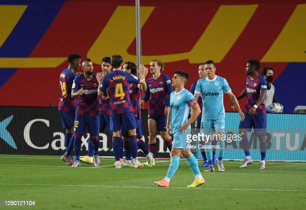 Antoine Griezmann of Barcelona celebrates with his team during the Liga match between FC Barcelona and CD Leganes at Camp Nou on June 16 2020 in...