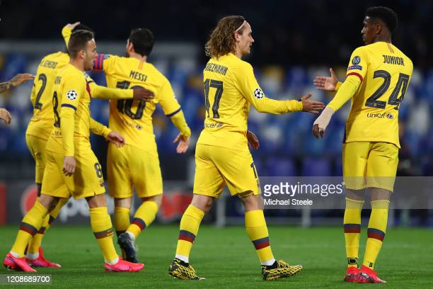 Antoine Griezmann of Barcelona is congratulated by Junior Firpo after scoring the equalising goal during the UEFA Champions League round of 16 first...