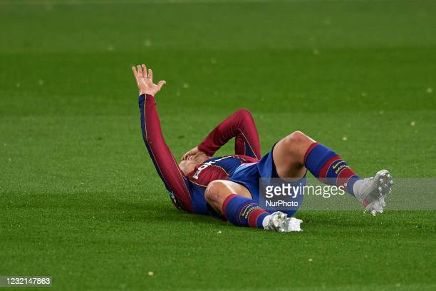 Antoine Griezmann of Barcelona lies injured on the pitch during the La Liga Santander match between FC Barcelona and Real Valladolid CF at Camp Nou...