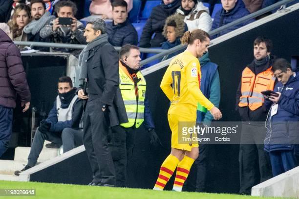 Antoine Griezmann of Barcelona walks pas head coach Ernesto Valverde after being substituted during the Espanyol V Barcelona La Liga regular season...