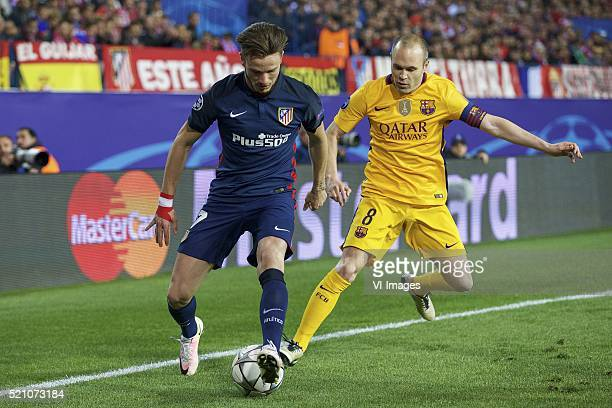 Antoine Griezmann of Club Atletico de Madrid Andres Iniesta of FC Barcelona during the UEFA Champions League quarterfinal match between Atletico...