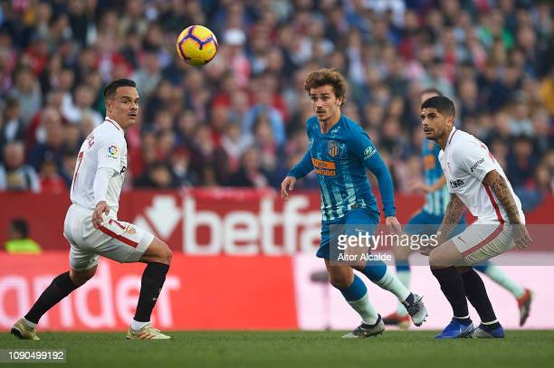 Antoine Griezmann of Club Atletico de Madrid being followed by Roque Mesa of Sevilla FC and Ever Banega of Sevilla FC during the La Liga match...