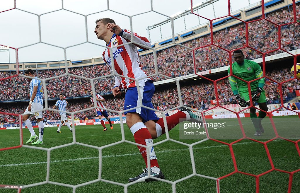 Antoine Griezmann of Club Atletico de Madrid celebrates after scoring his team's 2nd goal during the La Liga match between Club Atletico de Madrid and Malaga CF at Vicente Calderon Stadium on November 22, 2014 in Madrid, Spain.