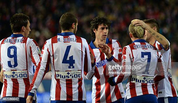 Antoine Griezmann of Club Atletico de Madrid celebrates with his teammates after scoring a goal during the La Liga match between Club Atletico de...