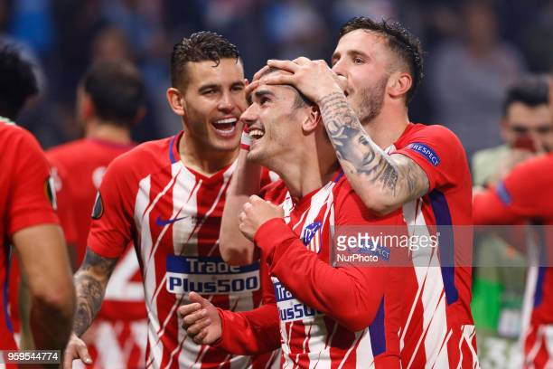Antoine Griezmann of Club Atletico de Madrid celebrates with teammate after scoring his sides second goal during the UEFA Europa League Final between...