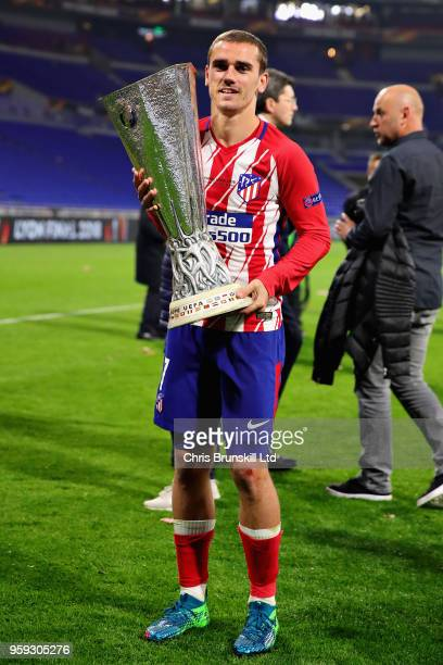 Antoine Griezmann of Club Atletico de Madrid celebrates with the trophy after winning the UEFA Europa League Final between Olympique de Marseille and...